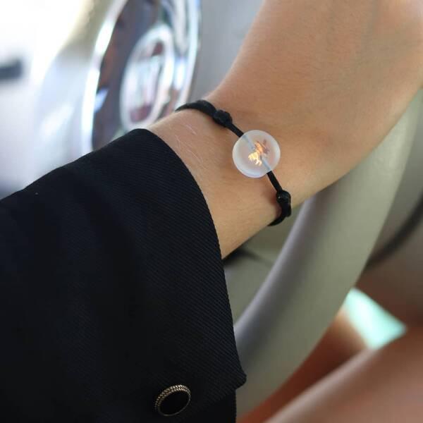 bracelet-chardon-incolore-sur-cordon